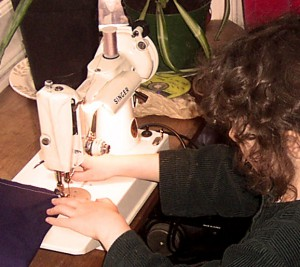 Teaching a child to quilt